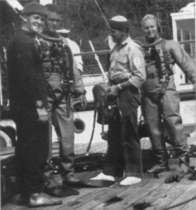 Divers being dressed and briefed.  (L to R)  Ron Titcombe; Bill Fitzgerald; Keith Gregson; 'Pony' Moore, and John Ingram
