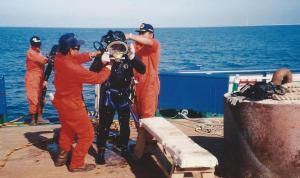 Undressing diver before entry to the chamber for surface decompression breathing oxygen