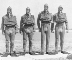 "Early Royal Navy Dry suits worn by 'Shallow Water Divers"" using O2 sets."